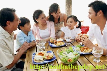 Three generation family having a meal